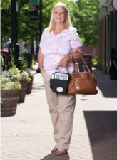lady with oxygen concentrator outside