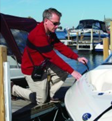 person on boat with portable oxygen concentrator